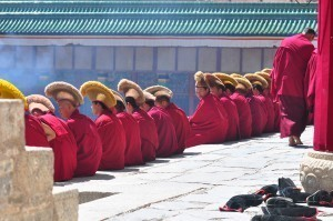 China motorcycle tour experiences prayer time at the Labrang Monastery