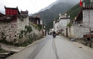 China motorcycle tour enters Danba with its tower houses
