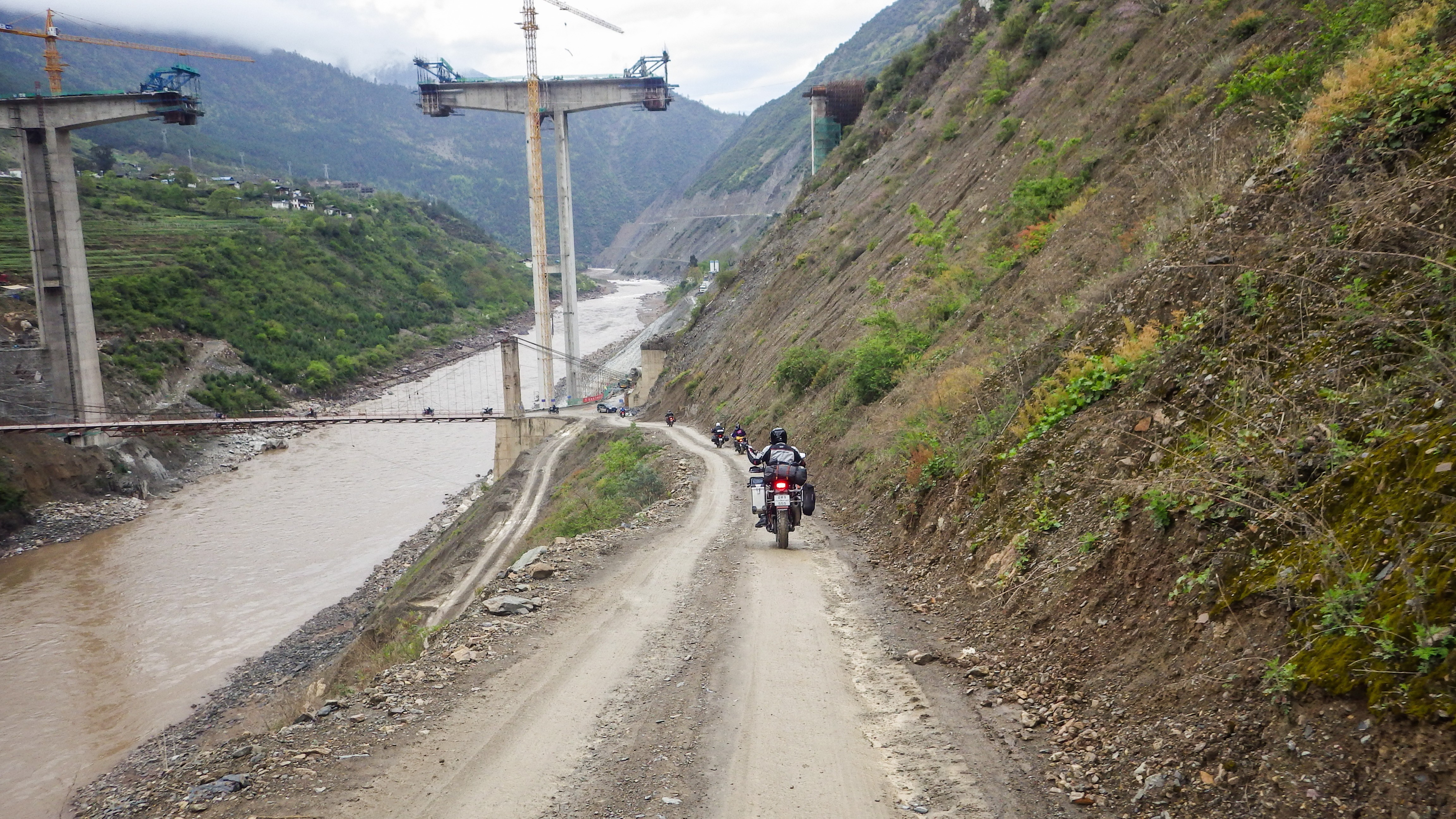 China motorcycle tour group crosses the Mekong River