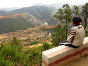 China motorcycle tour looking over the terraced rice fields